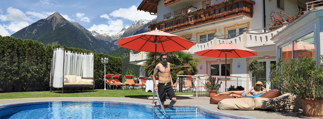 Man in costume is about to enter the pool of the Hotel Grafenstein